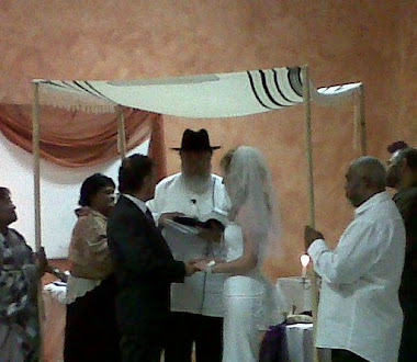 Messianic Hebrew wedding under a chuppah held by 4 people