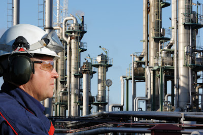 Chemical Plant Superstructure and Worker
