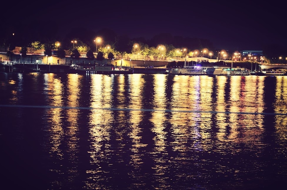 a view of the seine river at midnight in paris