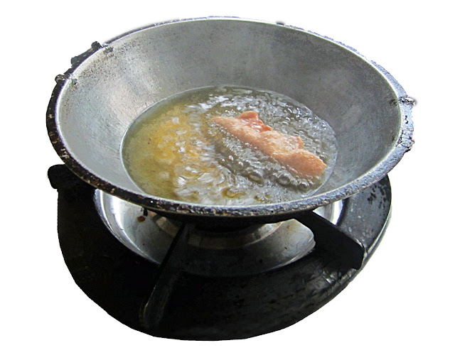 food being fried in smoking hot oil