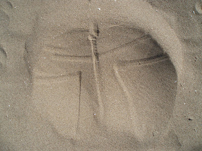 jeans butt imprint in the sand