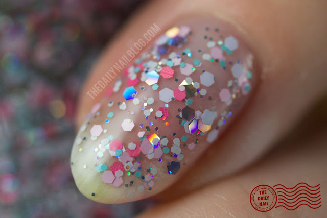 Morgan Taylor Ooh La La Escar-Go to France swatch, close-up, glitter