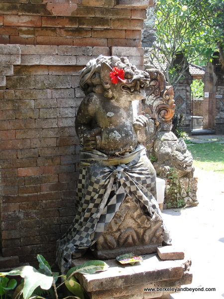 statue covered in black-and-white checked cloth to keep a balance between evil and good in Bali