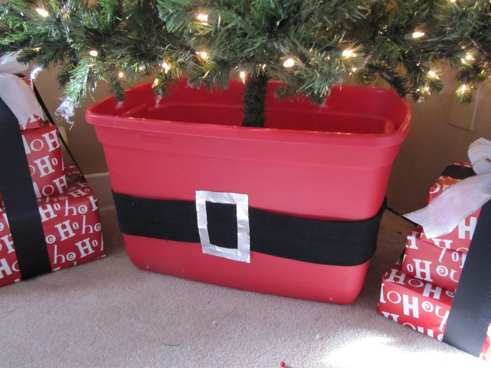 the tree stem was too tall and bare looking for me so hiding it in the container helps - Christmas Tree Storage Ideas