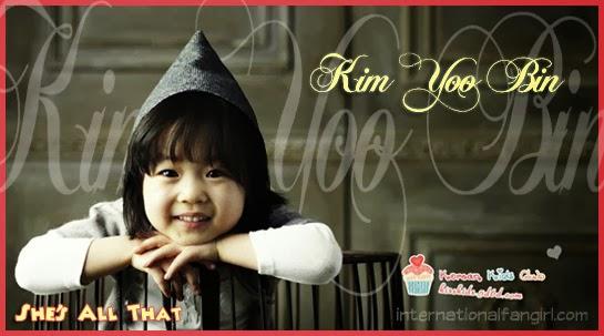 Kim Yoo Bin 김유빈 poses in a hoodie.