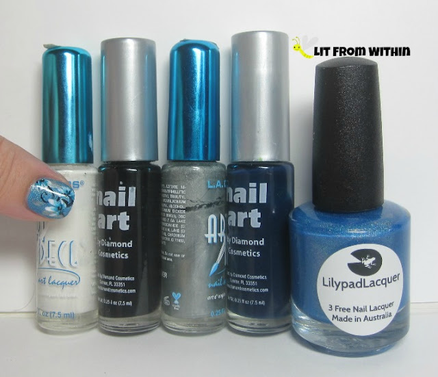 nail art stripers in white, black, silver, and a dark blue jelly, as well as Lilypad Lacquer Bluebell