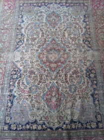 Worn Persian Carpet