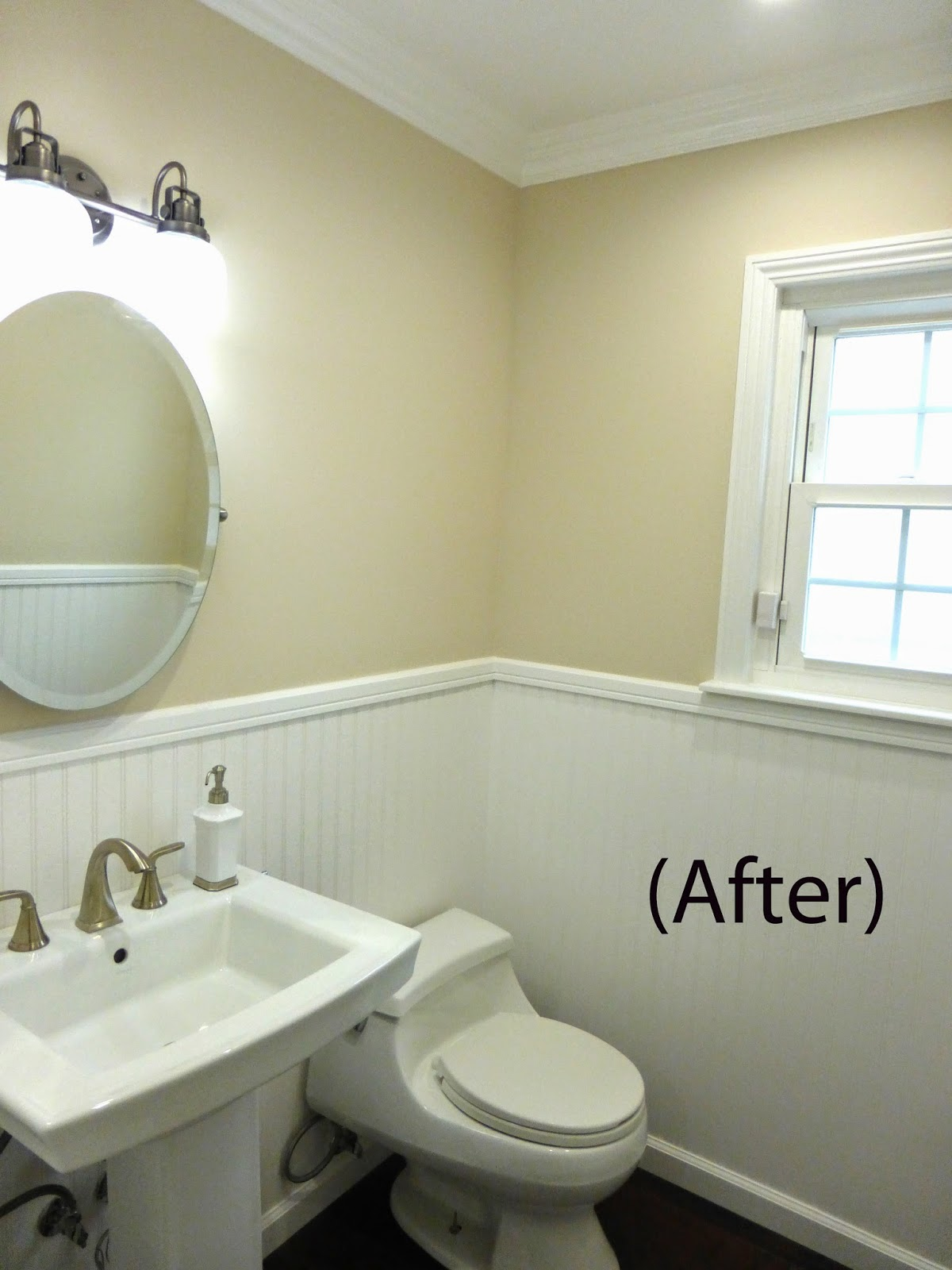 Updated entire look of the guest bathroom adding wainscoting, new sink