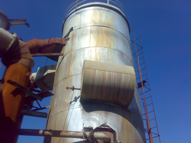 Sulfuric Acid Plant in Pakistan Zimindar Chemical 100 Metic ton daily production by contact process single absorption, between chiniot and faisalabad, near madina sugar mill, image by irfan ahmad plant operator, contact tower/convertor insulated by glass wool, sampling lines.