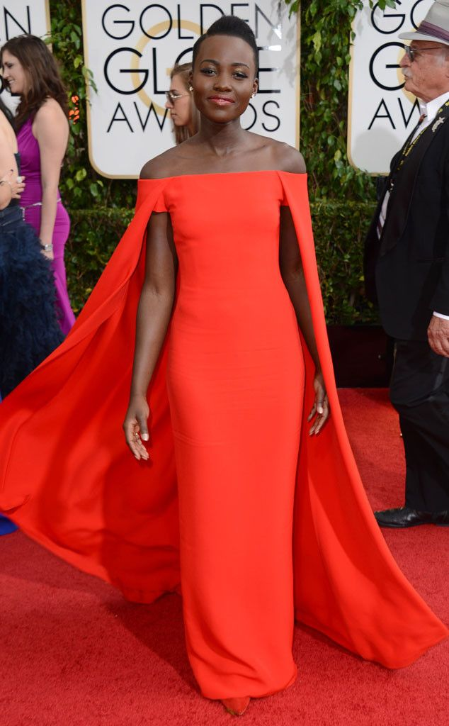Lupita Nyong'o in a red Ralph Laurent gown with cape at the 2014 Golden Globe Awards
