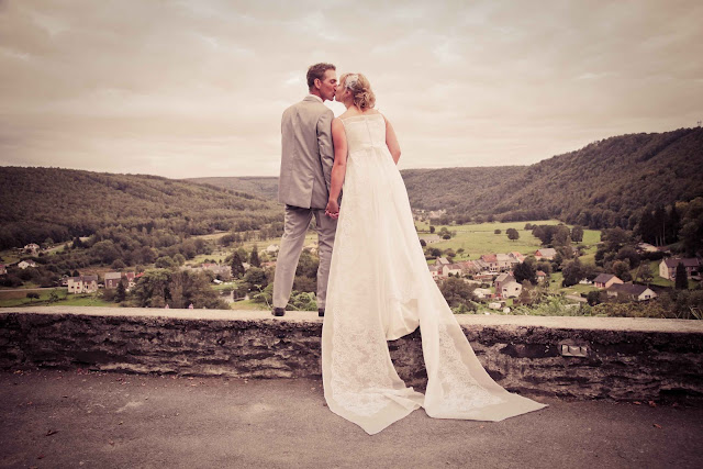 A bride and groom at the top of a mountain in France