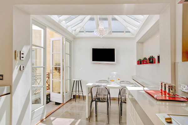Two level bright white home interior design with balcony