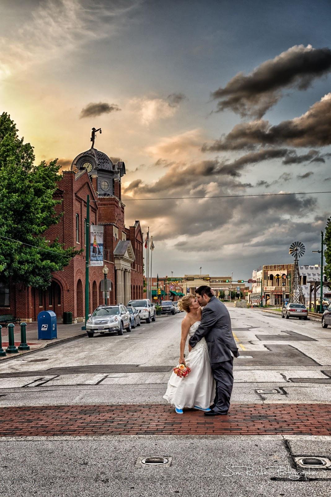 wedding kiss on Main Street Grapevine, texas