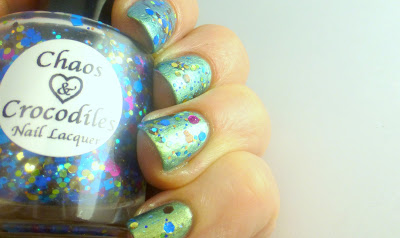 Those colorful pops of opaque, metallic, and holographic circles?  Well, they make me absolutely swoon!  In the course of the last week, I've worn Pass the Sprinkles over a variety of shades and formulas, and the coolest thing I've discovered is this:  It looks completely unique on each and every manicure.