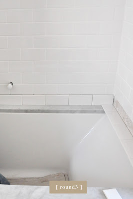 Craftsman bungalow renovation progress. Master bathroom marble tub surround. traditional bathroom.