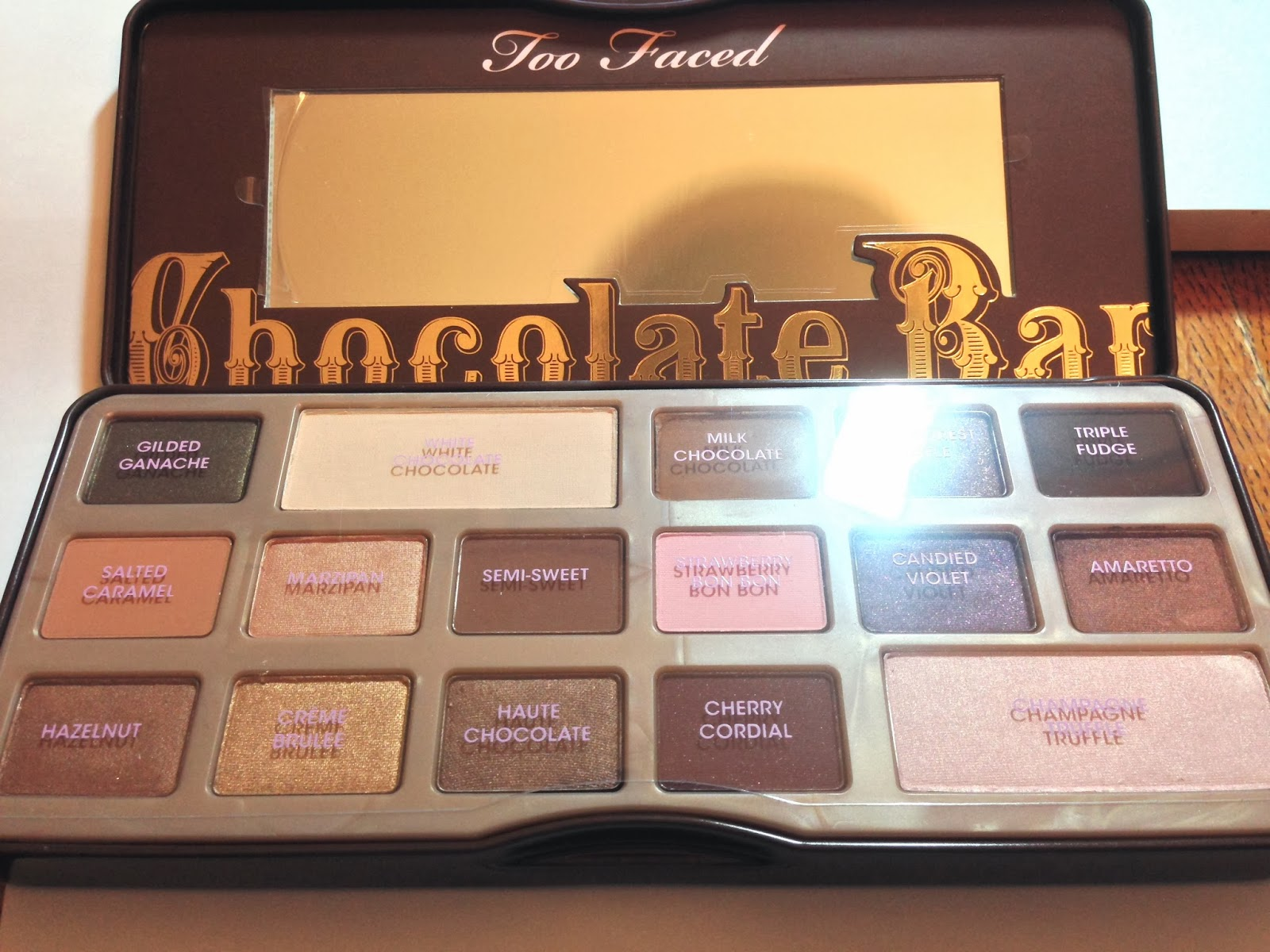 It is vaguely reminiscent of Willy Wonka and the Chocolate Factory (the movie) and I half expected to find a Golden Ticket inside the box. & Editions of Me: Too Faced Chocolate Bar palette Aboutintivar.Com