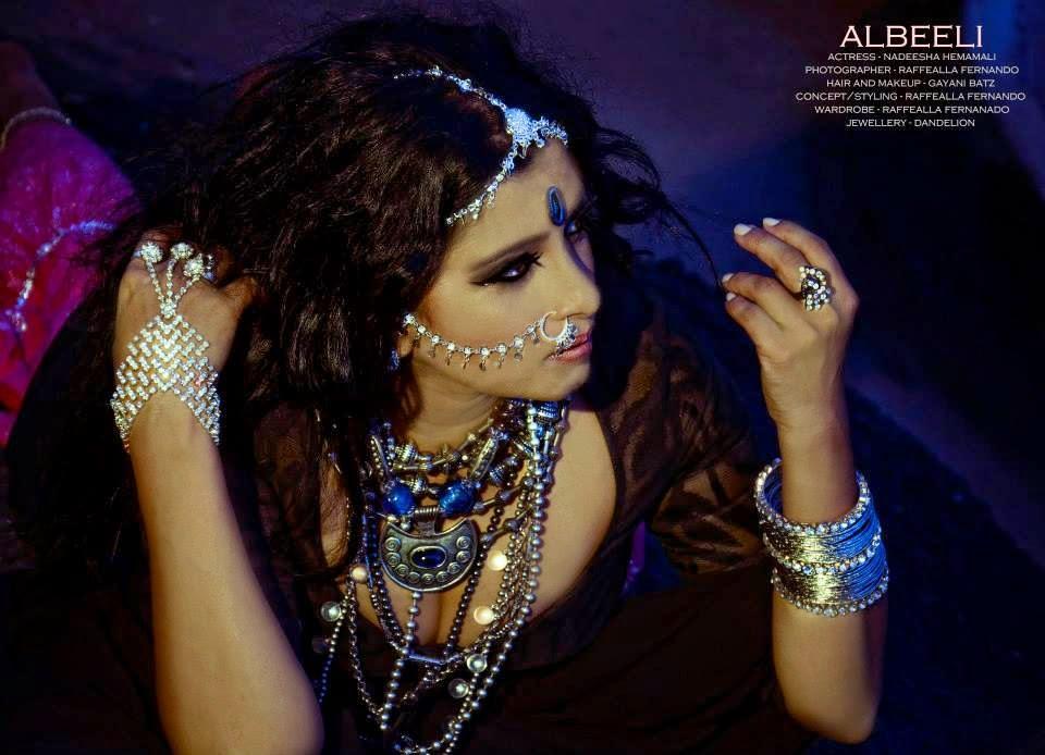 http://picture.gossiplankahotnews.com/2014/03/the-wild-gypsy-girl-nadeesha-hemamali.html