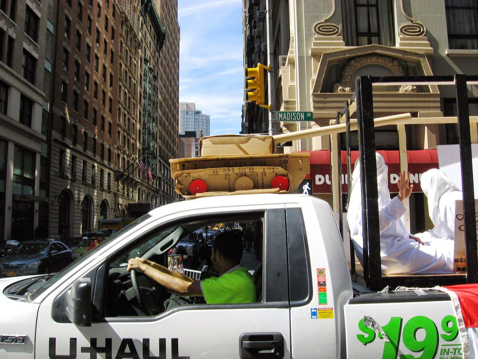 Urban infidel isis cages first seen rolling down madison avenue at the 2014 muslim day parade