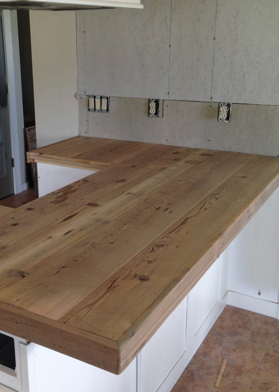 Diy reclaimed wood countertop averie lane diy reclaimed wood diy reclaimed wood countertop adding trim boards along edge solutioingenieria Images