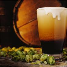 Photo of a glass of craft beer, hops.
