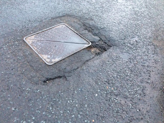 Potholes on Tom Johnston Road near Sainsburys supermarket