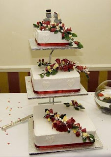 Square Wedding Cake Decorated with Red Ribbon & Small Flowers