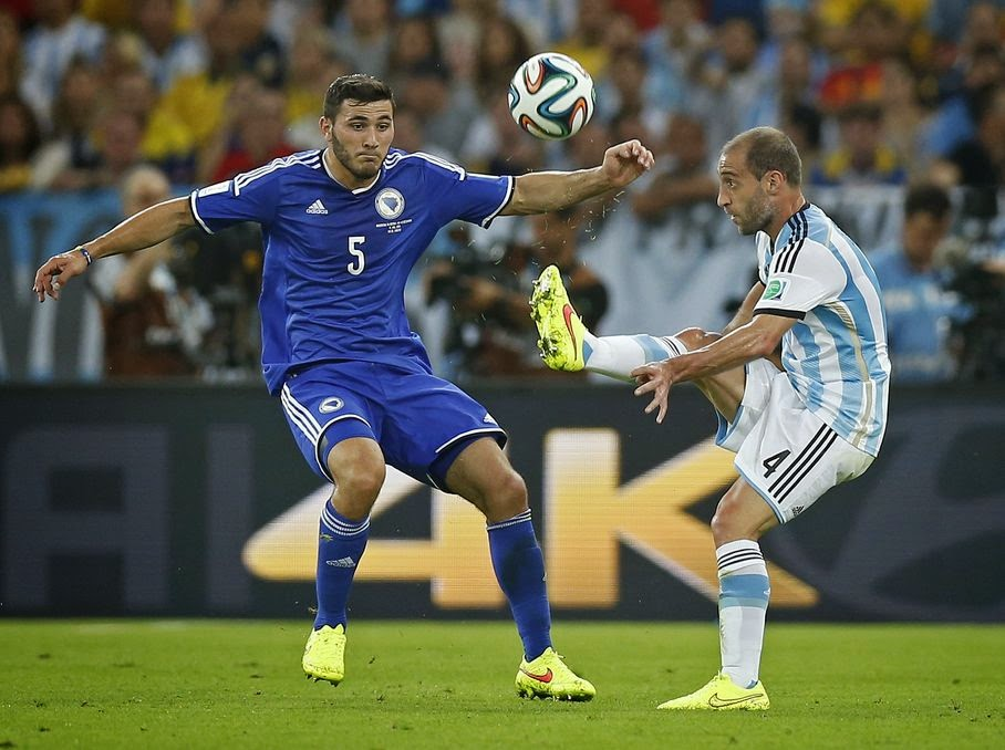 Bosnia's Sead Kolasinac, left, closes down Argentina's Pablo Zabaleta during the group F World Cup soccer match between Argentina and Bosnia at the Maracana Stadium in Rio de Janeiro, Brazil, Sunday, June 15, 2014.