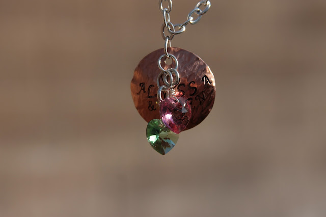 Stamped and hammered copper with Swarovski crystal hearts in birthstone colors of my children.