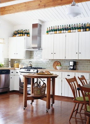 mylittlehousedesign.com wine bottles on top of kitchen cabinets