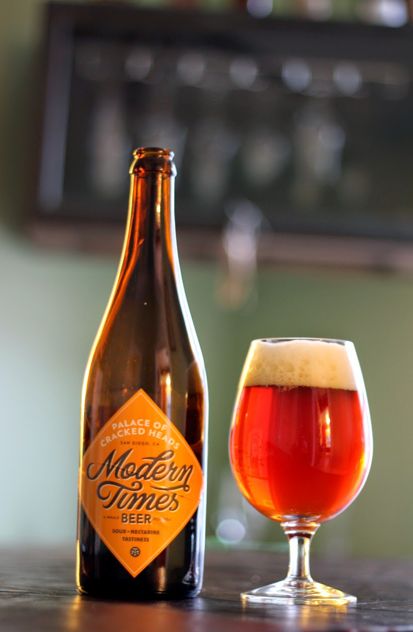A glass of Modern Times Palace of the Cracked Head. An oud bruin on nectarines.