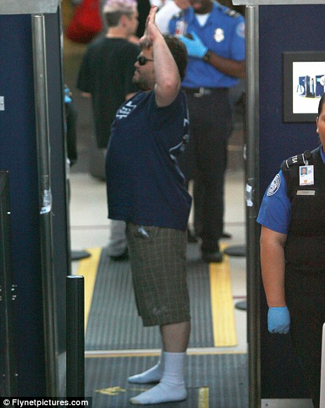 You might need a bigger scanner there Jack! A rotund looking Black goes through LAX security