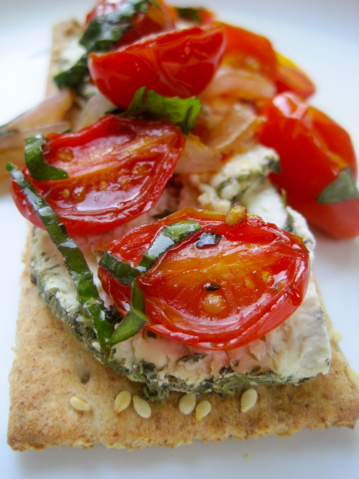 ... cracker topped with herbed goat cheese and warm, roasted tomato sauce