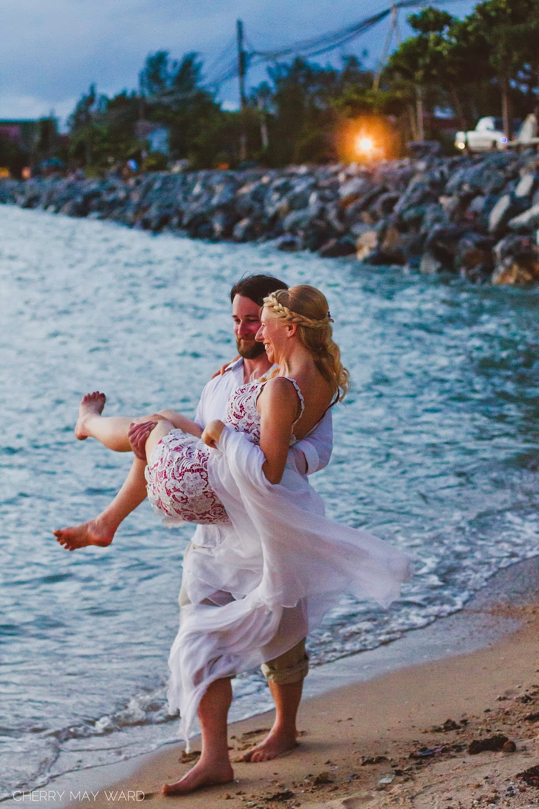 groom carrying bride along the beach, beautiful photos, intimate wedding portraits on Koh Samui, wedding photos on the beach after sunset,  bride and groom having fun on the beach, bride and groom being themselves, just married couple walking on the beach, groom carrying the bride, Cherry May Ward Photography