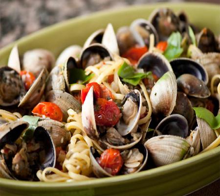 Add the basil, taste to adjust the seasonings, and serve.