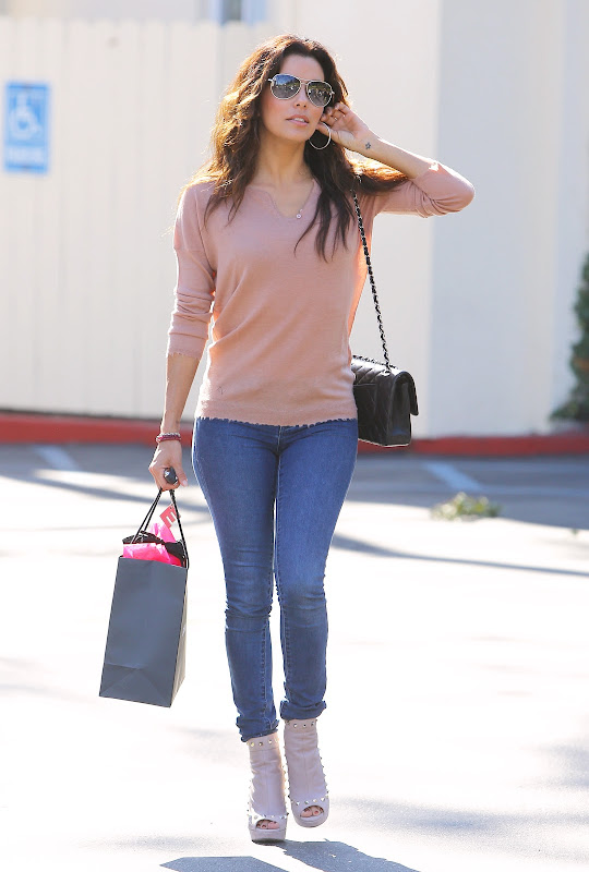 Eva Longoria wearing tight denim pants