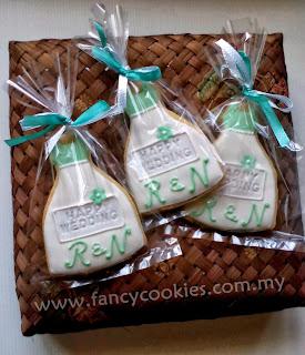 door gift fancy cookies wedding dress mint green with couple's initial