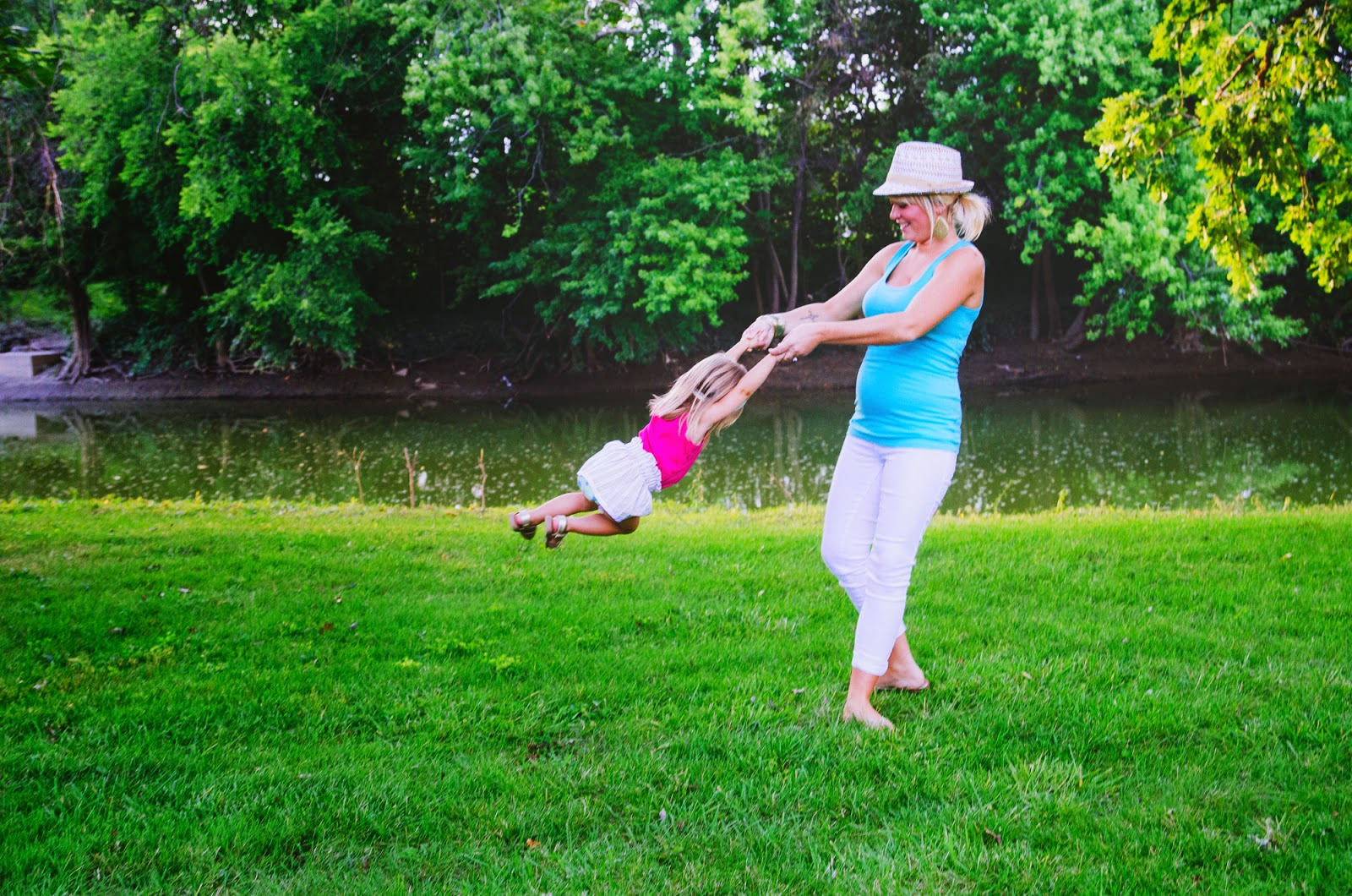 mom plays with daughter by river indianapolis family photographer