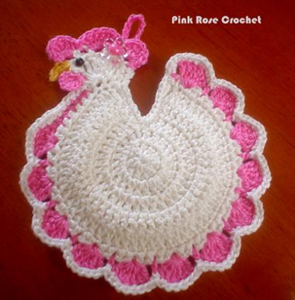 Agarradera con forma de gallina blanca y rosa