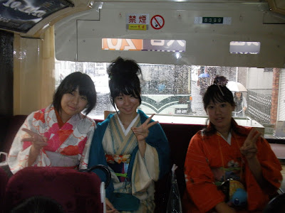 Girls wearing yukata on a bus, Osaka