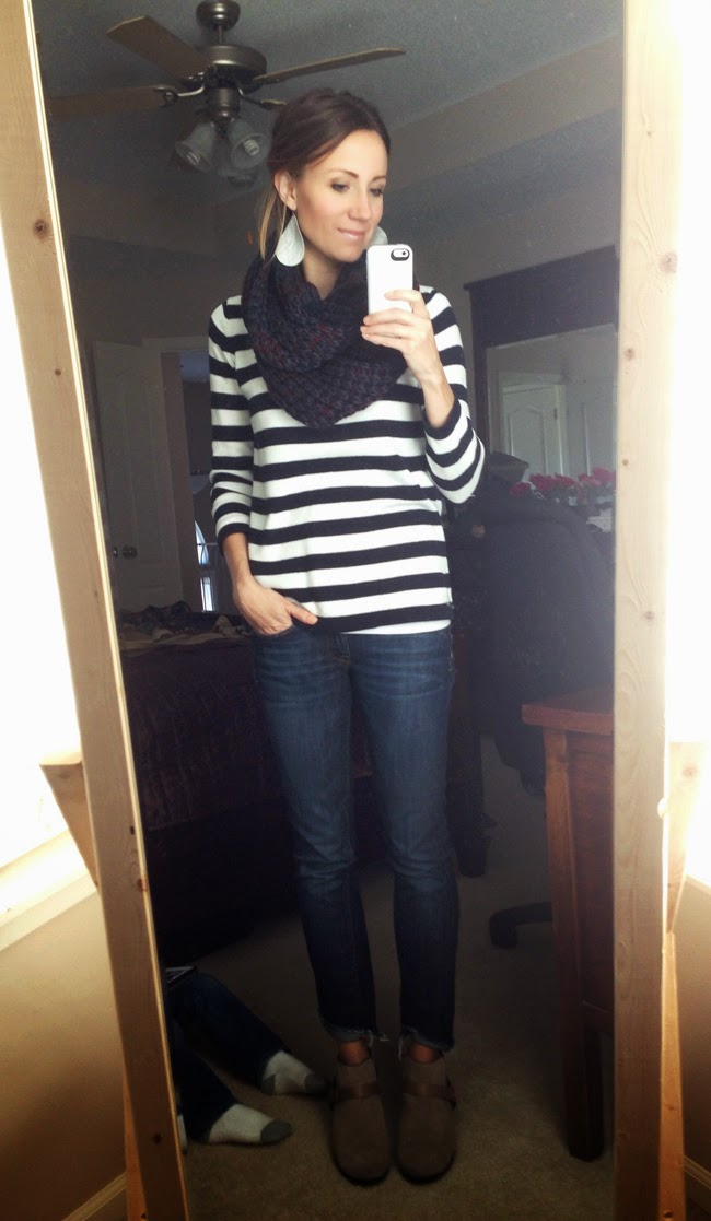 Chunky infinity scarf, striped sweater, dark denim and ankle boots