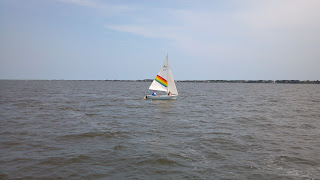 sail boat with rainbow sail