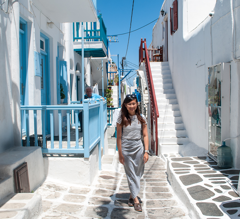 outfit of the day against white building walls in mykonos town