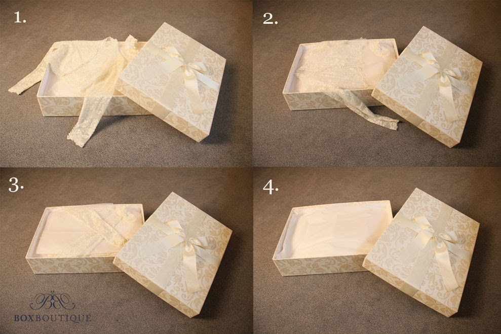 Accessoires wie z.B. Schleier oder Bolero können Sie auf das Brautkleid legen. Umwickeln Sie sie ebenfalls sanft mit Seidenpapier.