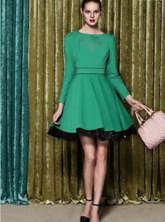 Vestido verde corte A de manga larga, cuello redondo y falda con borde negro