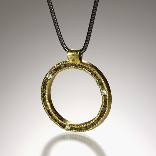 http://www.quadrumgallery.com/jewelry/product/diamond-circle-necklace