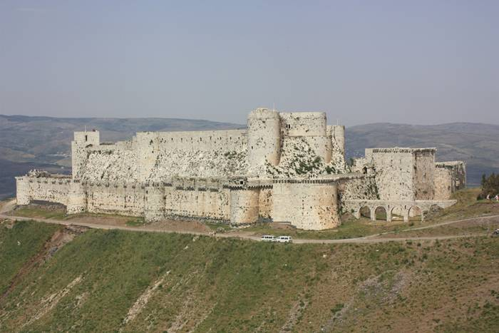 "Krak des Chevaliers, also Crac des Chevaliers, is a Crusader castle in Syria and one of the most important preserved medieval castles in the world. The site was first inhabited in the 11th century by a settlement of Kurds; as a result it was known as Hisn al Akrad, meaning the ""Castle of the Kurds"". In 1142 it was given by Raymond II, Count of Tripoli, to the Knights Hospitaller. It remained in their possession until it fell in 1271."