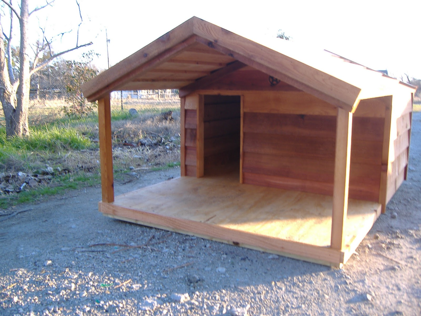 Custom cedar dog house with porch custom ac heated for Insulated heated dog house