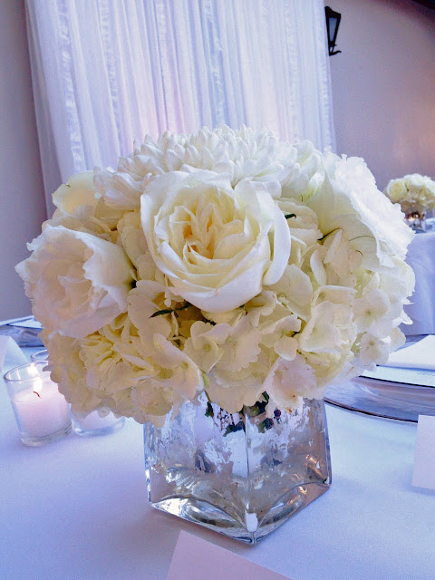 white rose and hydrangea centerpiece in silver mercury glass