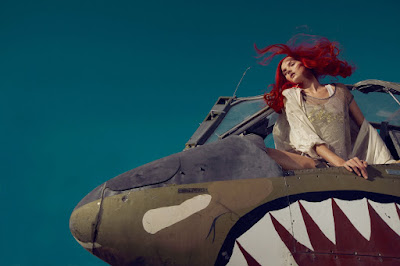 tiger shark airplane, woman in airplane, fashion and beauty photographer jamie nelson