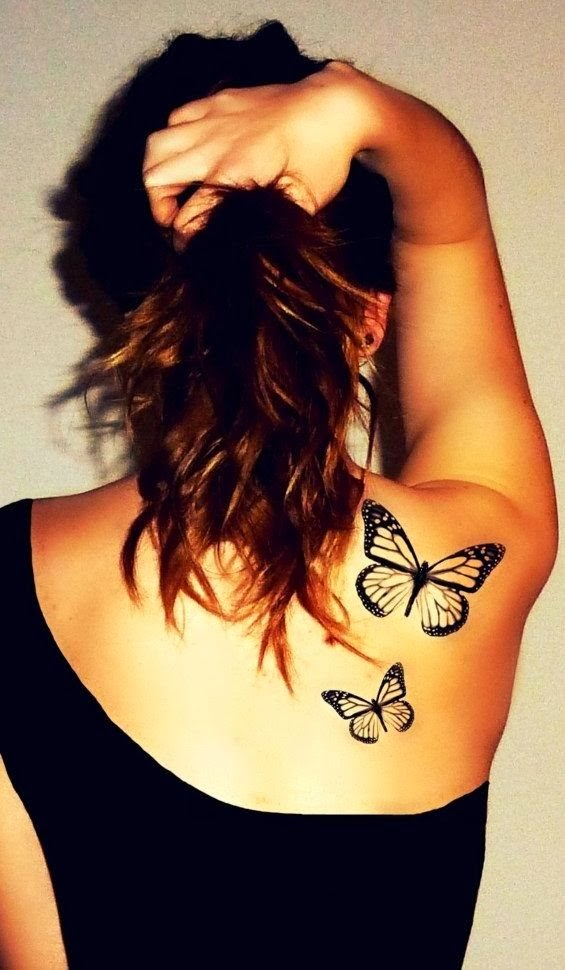 Black ink flying butterflies tattoo on back